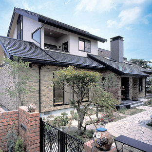 Design ideas for a large asian brick brown exterior in Other with three or more storeys and a gable roof.