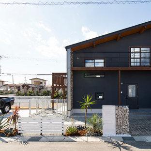 他の地域のトロピカルスタイルのおしゃれな家の外観の写真