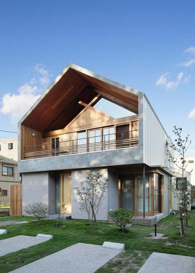 コンテンポラリー 家の外観 by TSC Architects