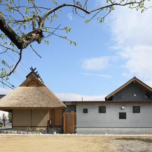 京都のアジアンスタイルのおしゃれな平屋 (マルチカラーの外壁、戸建) の写真