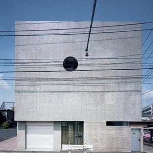 東京23区の中くらいのモダンスタイルのおしゃれな家の外観 (コンクリートサイディング、グレーの外壁) の写真