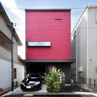 大阪のコンテンポラリースタイルのおしゃれな家の外観 (混合材サイディング、赤い外壁) の写真