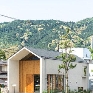 京都のアジアンスタイルのおしゃれな家の外観 (混合材サイディング) の写真