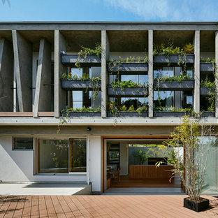 名古屋のコンテンポラリースタイルのおしゃれな二階建ての家 (コンクリートサイディング、グレーの外壁、陸屋根、戸建) の写真