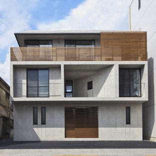 東京23区のモダンスタイルのおしゃれな家の外観 (コンクリートサイディング、グレーの外壁) の写真