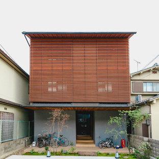 京都のモダンスタイルのおしゃれな家の外観 (グレーの外壁) の写真
