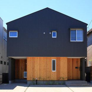 名古屋のモダンスタイルのおしゃれな家の外観 (黒い外壁) の写真
