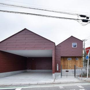 他の地域の北欧スタイルのおしゃれな切妻屋根の家 (赤い外壁) の写真