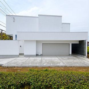 東京都下のコンテンポラリースタイルのおしゃれな家の外観 (漆喰サイディング) の写真
