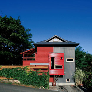 Example of an asian red two-story metal exterior home design in Sapporo with a hip roof