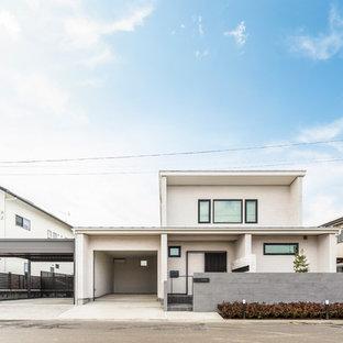 他の地域のコンテンポラリースタイルのおしゃれな家の外観 (漆喰サイディング) の写真