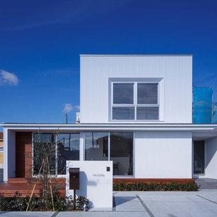 他の地域のコンテンポラリースタイルのおしゃれな家の外観 (片流れ屋根、戸建、金属屋根、メタルサイディング) の写真