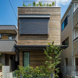 東京23区のコンテンポラリースタイルのおしゃれな家の外観 (木材サイディング、緑化屋根) の写真