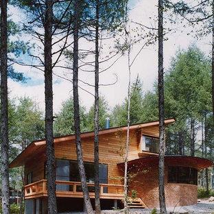 Exemple d'une façade de maison asiatique.