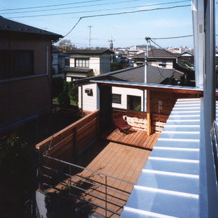 Mid-sized zen gray two-story concrete house exterior idea in Tokyo with a shed roof and a metal roof