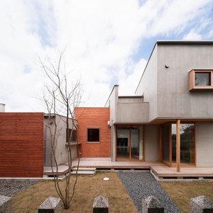 名古屋のコンテンポラリースタイルのおしゃれな陸屋根の家 (グレーの外壁) の写真