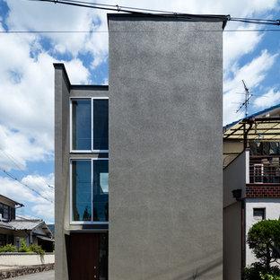 大阪のインダストリアルスタイルのおしゃれな陸屋根 (グレーの外壁) の写真