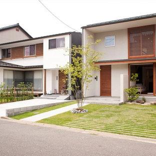Modelo de fachada de casa blanca de estilo zen