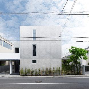 東京23区のモダンスタイルのおしゃれな陸屋根 (コンクリートサイディング、グレーの外壁) の写真