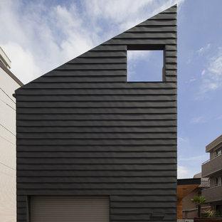 Foto de fachada de piso negra, contemporánea, con tejado de un solo tendido