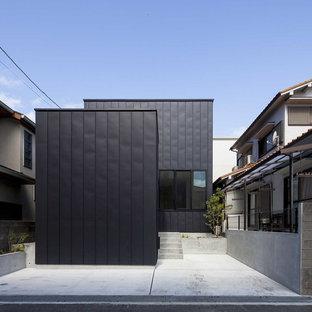 他の地域のコンテンポラリースタイルのおしゃれな家の外観 (メタルサイディング、黒い外壁、片流れ屋根、戸建、金属屋根) の写真