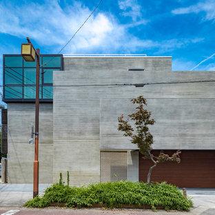 名古屋のモダンスタイルのおしゃれな家の外観 (石材サイディング、グレーの外壁) の写真