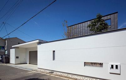 屋外テラスを共有する二世帯の暮らし、光の降り注ぐ美しい室内《浜寺公園の家》
