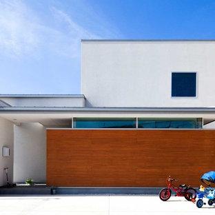 他の地域の中くらいの北欧スタイルのおしゃれな家の外観 (混合材サイディング、長方形) の写真