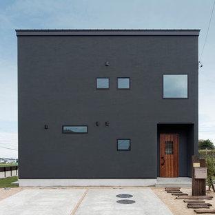 他の地域のコンテンポラリースタイルのおしゃれな家の外観 (黒い外壁、陸屋根) の写真