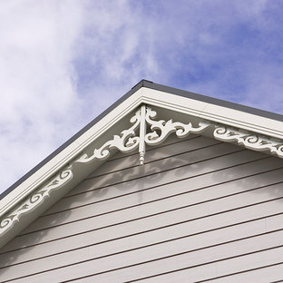 Ornate white two-story mixed siding house exterior photo in Other
