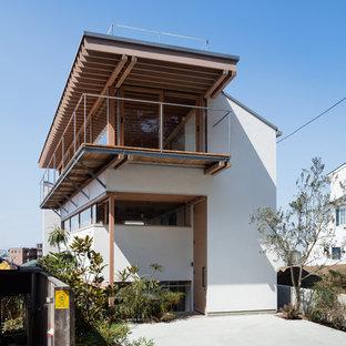 横浜のアジアンスタイルの家の外観の画像 (陸屋根、戸建)