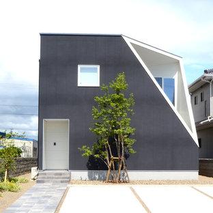 コンテンポラリースタイルのおしゃれな一戸建ての家 (グレーの外壁) の写真