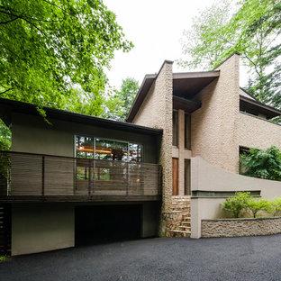 ミッドセンチュリースタイルのおしゃれな家の外観 (石材サイディング) の写真