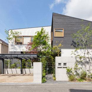 神戸のアジアンスタイルのおしゃれな陸屋根の家 (マルチカラーの外壁) の写真