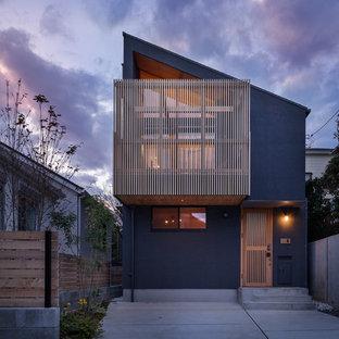 横浜のコンテンポラリースタイルのおしゃれな家の外観 (グレーの外壁、片流れ屋根、戸建) の写真