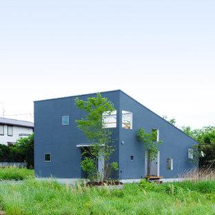 他の地域のモダンスタイルのおしゃれな家の外観 (グレーの外壁、片流れ屋根) の写真