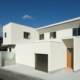 他の地域の中くらいのモダンスタイルのおしゃれな家の外観 (コンクリート繊維板サイディング) の写真