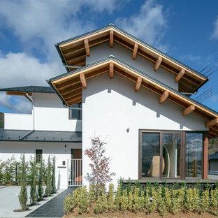 京都の中くらいのアジアンスタイルのおしゃれな家の外観の写真