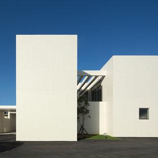 他の地域のモダンスタイルのおしゃれな家の外観 (コンクリートサイディング、陸屋根、戸建) の写真