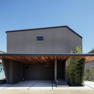 東京23区のコンテンポラリースタイルのおしゃれな切妻屋根の家 (黒い外壁) の写真
