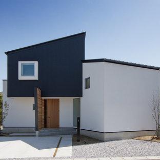 他の地域の北欧スタイルのおしゃれな家の外観 (混合材サイディング) の写真
