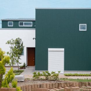 Foto de fachada de casa verde, contemporánea, con revestimientos combinados y tejado plano