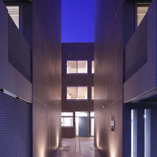 Réalisation d'un grand façade d'immeuble minimaliste.