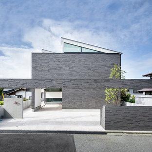 他の地域の中くらいのモダンスタイルのおしゃれな家の外観 (石材サイディング、グレーの外壁) の写真
