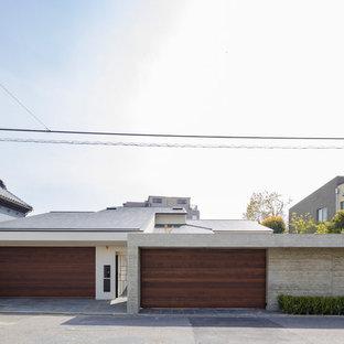 名古屋のモダンスタイルのおしゃれな家の外観 (グレーの外壁) の写真