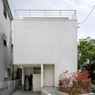 横浜の小さいコンテンポラリースタイルのおしゃれな家の外観 (漆喰サイディング) の写真