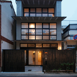 This is an example of an asian grey exterior in Kyoto with three or more storeys.