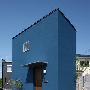 他の地域のモダンスタイルのおしゃれな青い家の写真