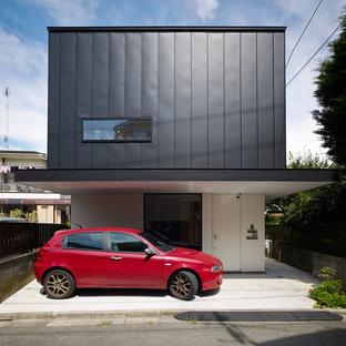 横浜のモダンスタイルの家の外観の画像 (マルチカラーの外壁、陸屋根)