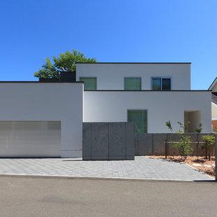 札幌のコンテンポラリースタイルのおしゃれな家の外観 (陸屋根、戸建) の写真